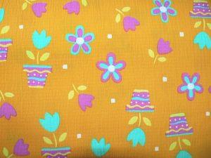 Bertička - oranžovožlutý krep s dětským motivem