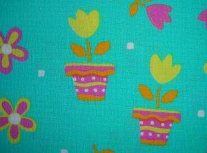 Bertička - zelený krep s dětským motivem