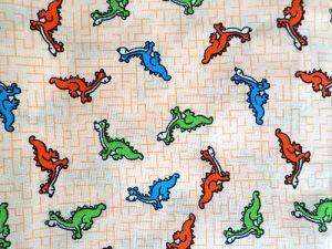 Dráčci - sv. oranžová bavlna s dráčky